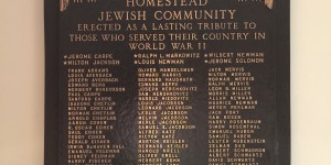 Re-made WWII plaque hanging in Beth Shalom