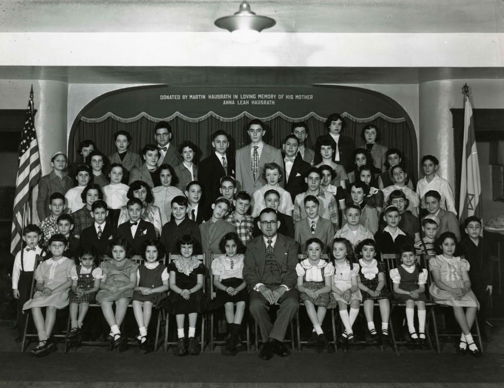 Rabbi Joshua Weiss with Sunday School students, c. 1950