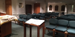 Another view towards the back of the room showing the two alcoves where the yahrzeit tablets and veterans plaques are.